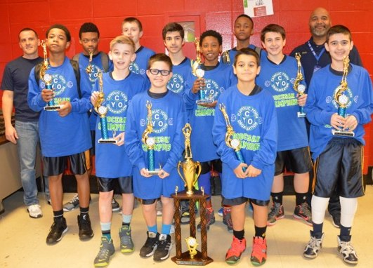 The team celebrating their victory and enjoying their trophies after the championship game